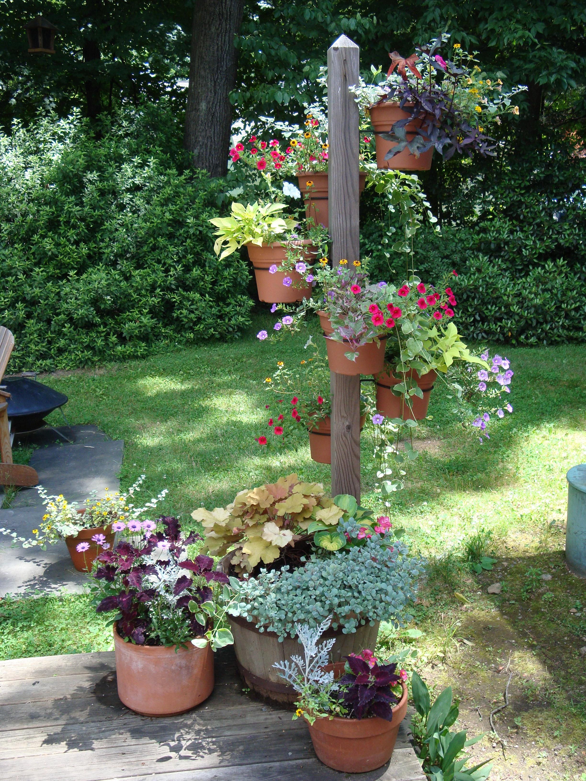 Garden designers roundtable vertical accents hanging pots on post workwithnaturefo