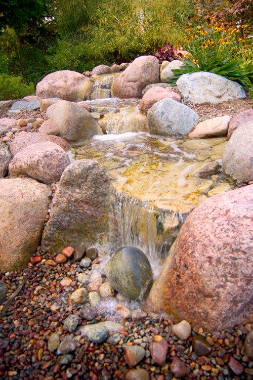 A pondless waterfall from Aquascapes, Inc. offer sound and movement, without the maintenance of a pond.